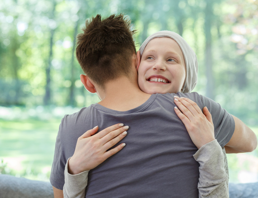 cancer patient hugging a friend